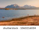 landscape of the lake at sunset ... | Shutterstock . vector #1063216034