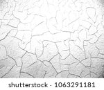 background. white cracked wall. | Shutterstock . vector #1063291181