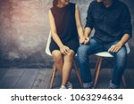 young couples sitting on a... | Shutterstock . vector #1063294634