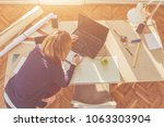 female architect in a bright... | Shutterstock . vector #1063303904