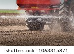 tractor spraying pesticides on... | Shutterstock . vector #1063315871