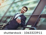 young business man talking on... | Shutterstock . vector #1063323911