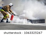 extinguishing a major fire. a... | Shutterstock . vector #1063325267