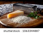 freshly grated parmesan cheese... | Shutterstock . vector #1063344887