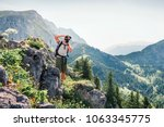 photographer takes picture... | Shutterstock . vector #1063345775