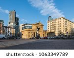 Milan Italy. Street scene at Porta Nuova, one of the six main gates of Milan. Piazzale Principessa Clotilde (square Princess Clotilde). Contrast between modern and ancient