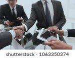 two businessmen handshaking ... | Shutterstock . vector #1063350374