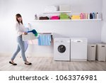 young woman carrying basket... | Shutterstock . vector #1063376981