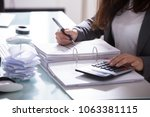 close up of a businesswoman's... | Shutterstock . vector #1063381115