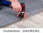 close up of a carpet fitter's... | Shutterstock . vector #1063381301