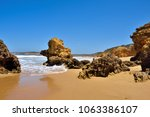 torquay is promoted as the... | Shutterstock . vector #1063386107