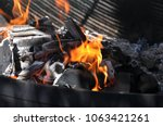 fire on the coals. preparation... | Shutterstock . vector #1063421261