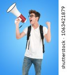 young student using a megaphone | Shutterstock . vector #1063421879