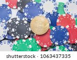bitcoin on pile of casino chips ... | Shutterstock . vector #1063437335
