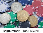 bitcoin on pile of casino chips ... | Shutterstock . vector #1063437341