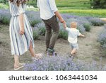 young couple on a walk with a... | Shutterstock . vector #1063441034