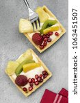 exotic fruit tarts on a rustic... | Shutterstock . vector #1063451507