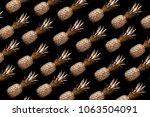 gold pineapple on black...   Shutterstock . vector #1063504091