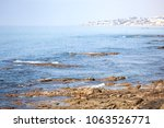 quiet scene of a bay with a... | Shutterstock . vector #1063526771