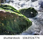 waves at the edge of the sea... | Shutterstock . vector #1063526774