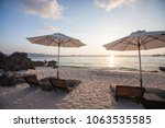 chaise longues at the beach on... | Shutterstock . vector #1063535585