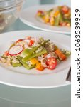 Small photo of Homemade Vegetable salat on white background