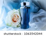 perfume bottle on a blue... | Shutterstock . vector #1063542044