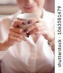 cute girl sitting in cafe ... | Shutterstock . vector #1063581479