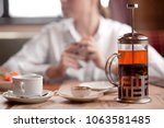 teapot with fruit tea  a cup of ... | Shutterstock . vector #1063581485