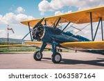 retro biplane gettring ready on ... | Shutterstock . vector #1063587164