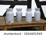 milk churns at a farm house | Shutterstock . vector #1063601969