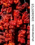 turkish dried tomatoes on a rope   Shutterstock . vector #1063605725
