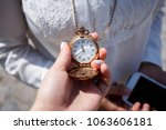 a girl holds in her hand an old ...   Shutterstock . vector #1063606181