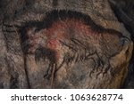 an ancient drawing of a bull on ... | Shutterstock . vector #1063628774