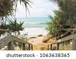 stairway to a heavenly beach... | Shutterstock . vector #1063638365