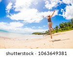 happy woman in holiday running...   Shutterstock . vector #1063649381