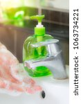Small photo of Hands washing in sanitary ware by gel alcohol and water for clear dirty things, germ, anti bacteria liquid soap in healthcare concept