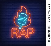 rap neon word and microphone in ... | Shutterstock .eps vector #1063747211