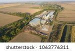 rice plant. hangar for storage... | Shutterstock . vector #1063776311
