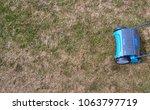 gardener operating soil... | Shutterstock . vector #1063797719