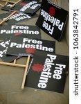 London, United Kingdom, 7st April 2018:- Placards near Downing Street in London to protest the recent killings of Palestinians in Gaza by the Israeli  army during of the Great Return March - stock photo