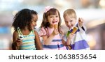 happy kids eating ice cream at... | Shutterstock . vector #1063853654