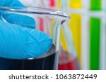 hand holding colorful liquid in ... | Shutterstock . vector #1063872449