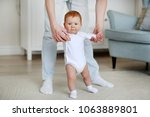 father and little dauther. baby ... | Shutterstock . vector #1063889801