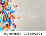 different pills on light... | Shutterstock . vector #1063892831