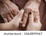 hands of asian teenage female... | Shutterstock . vector #1063899467