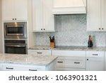 modern white kitchen in... | Shutterstock . vector #1063901321