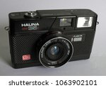 Small photo of LONDON, UNITED KINGDOM - APRIL 3, 2018: A Halina MW 35E 35mm camera, manufactured in Hong Kong by Haking. It offered a 38mm f1:4 Halinar lens, zone focusing, motor-wind and auto exposure.