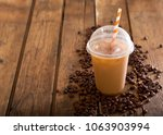 iced coffee in plastic glass... | Shutterstock . vector #1063903994