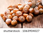 close up of hazelnuts on wooden ... | Shutterstock . vector #1063904027
